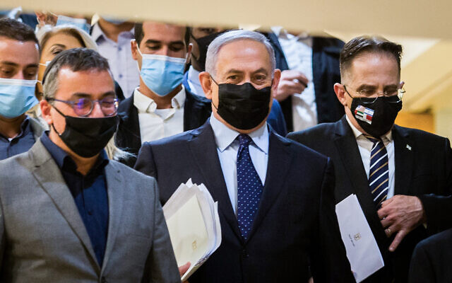 Prime Minister Benjamin Netanyahu (C) at the Knesset on November 10, 2020. (Oren Ben Hakoon/Pool/Flash90)