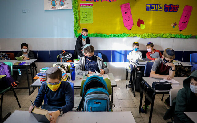 Students seen in a classroom at Orot Etzion School, in the settlement of Efrat, in the West Bank on November 24, 2020. (Gershon Elinson/Flash90)
