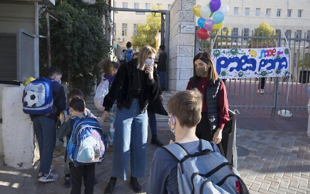 Illustrative: Children enter the Beit Hakerem school in Jerusalem on November 24, 2020 (Olivier Fitoussi/Flash90)