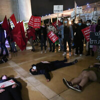 Activists protest against recent cases of violence against women at Habima square in Tel Aviv on November 25, 2020. (Miriam Alster/Flash90)