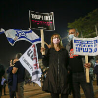 People protest against Prime Minister Benjamin Netanyahu at Rabin Square in Tel Aviv, on November 28, 2020 (Miriam Alster/Flash90)
