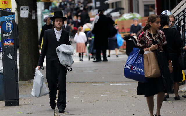 People walk through Williamsburg, one of several Orthodox neighborhoods in Brooklyn with rising COVID-19 rates, on October 1, 2020. (Spencer Platt/Getty Images)