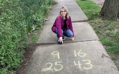 Leslie Frischman poses next to one of her sidewalk equations in this undated photo taken in 2020. (Courtesy)