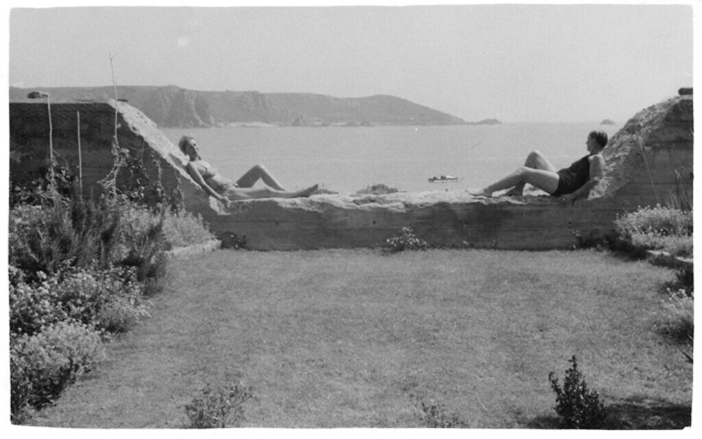 Lucy and Suzanne reclining at the water near their home in Jersey. (Jersey Heritage Collections/ via New York Jewish Week)