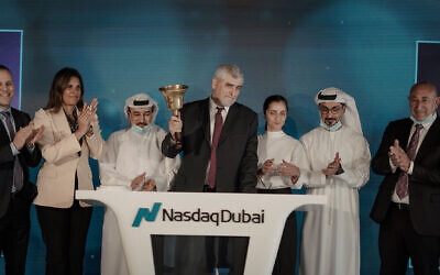 Bank Hapoalim delegation of Israeli businesspeople, led by Dov Kokler, rings the bell to begin the day's trading at the NASDAQ Dubai exchange in Sept. 2020. The delegation was welcomed by the exchange's president, Hamed Ali, and the president and the CEO of the Dubai stock exchange, Hassan Abdul Rahaman Alserka (Courtesy)
