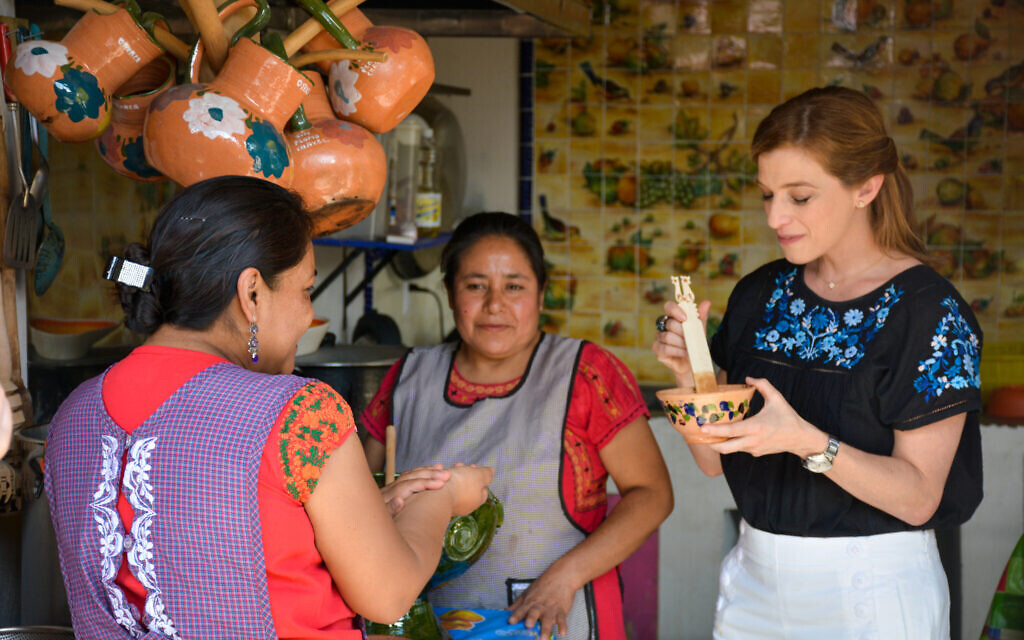 Celebrity chef Pati Jinich works with a mortar and pestle in Oaxaca. (Courtesy Jinich)