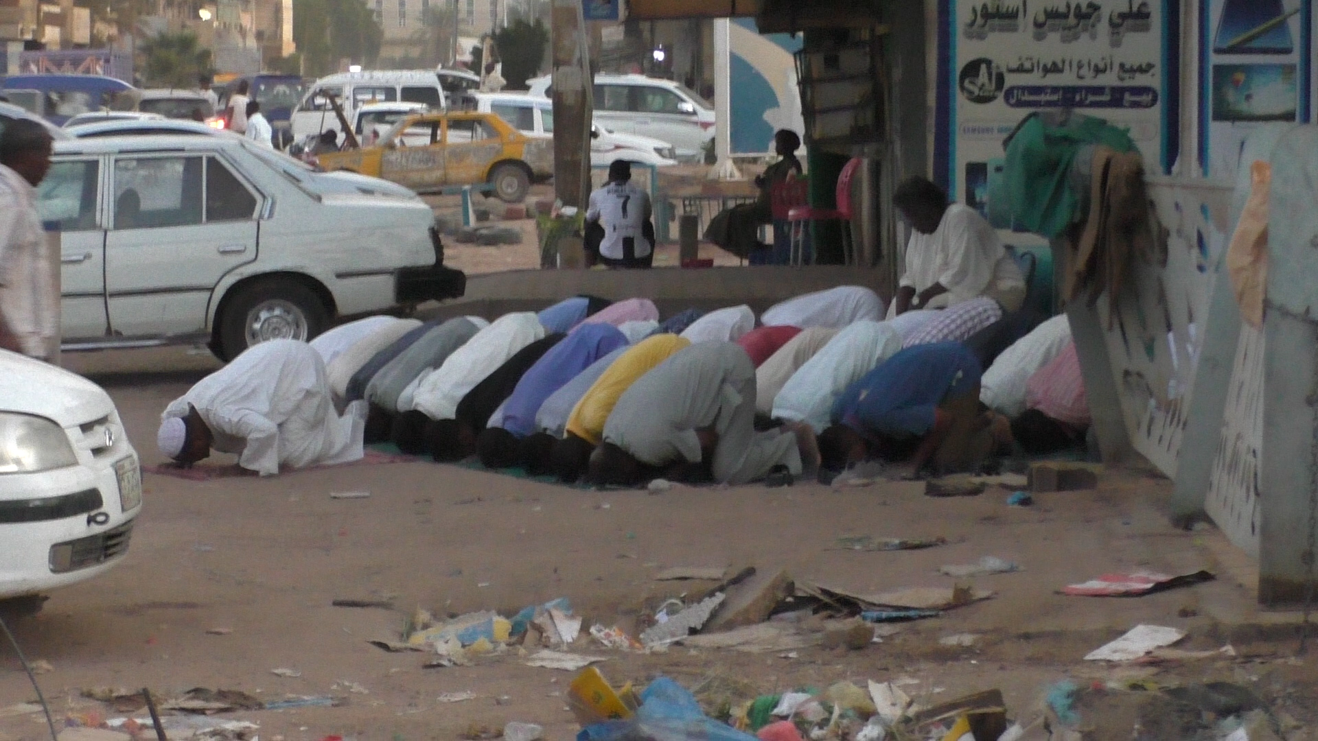 Muslim prayer service on a street in Khartoum, Sudan, November 2020. (Ziv Genesove)