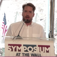 Darren Beattie speaks at the At the Wall Symposium on July 28, 2019. (Screen capture/YouTube)