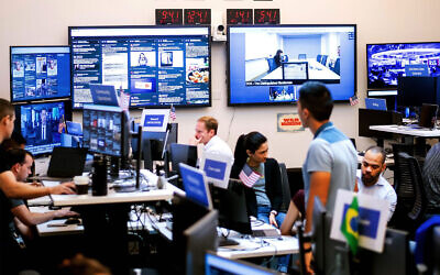Facebook employees work in a unit focused on the fight against misinformation and manipulation in Menlo Park, California, in 2018. (Noah Berger/AFP via Getty Images)