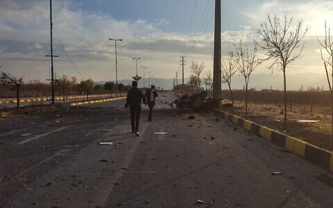 A photo released by Iran's semi-official Fars News Agency shows the scene where Mohsen Fakhrizadeh was killed in Absard, a small city just east of the capital, Tehran, Iran, Nov. 27, 2020. (Fars News Agency via AP)