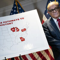 Rudy Giuliani stands next to a map during a press conference about various lawsuits related to the 2020 election, inside the Republican National Committee headquarters in Washington, November 19, 2020. (Drew Angerer/Getty Images/AFP)