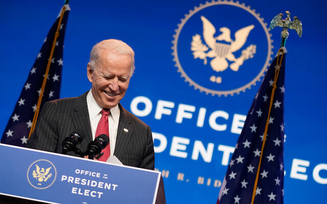 US President-elect Joe Biden, accompanied by Vice President-elect Kamala Harris, speaks at The Queen theater in Wilmington, Delaware, Nov. 19, 2020. (AP Photo/Andrew Harnik)