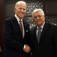 Then-US vice president Joe Biden, left, and Palestinian President Mahmoud Abbas, right, at the presidential compound in Ramallah, West Bank, March 9, 2016. (Debbie Hill, Pool via AP)