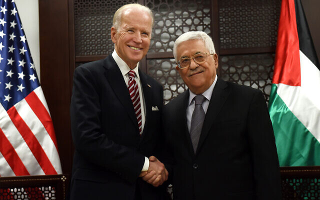 Then-US vice president Joe Biden, left, and Palestinian Authority President Mahmoud Abbas, right, at the presidential compound in Ramallah, March 9, 2016. (Debbie Hill, Pool via AP)