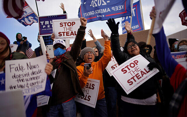 Supporters of US President Donald Trump protest the election outside of the Clark County Election Department in North Las Vegas, Nevada, Nov. 8, 2020. (AP Photo/John Locher)