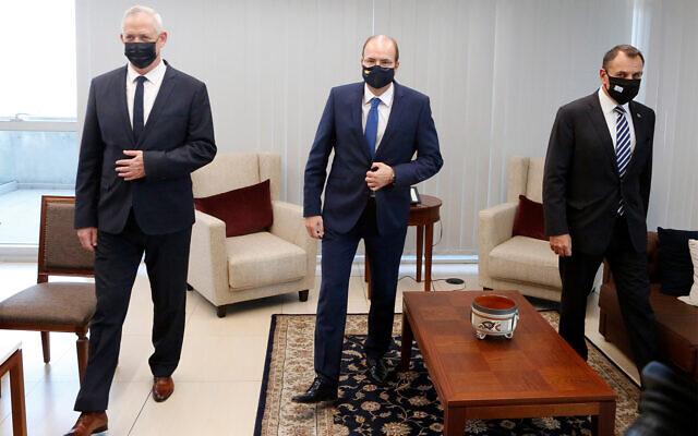 Defense Minister Benny Gantz, left, Cyprus Defense Minister Charalambos Petrides, center, and Greek Defense Minister Nikolaos Panagiotopoulos, right, ahead of a meeting in the Cypriot capital Nicosia, Nov. 12, 2020. (AP Photo/Petros Karadjias)