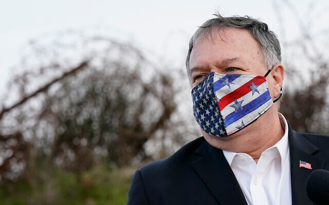 US Secretary of State Mike Pompeo listens as Foreign Minister Gabi Ashkenazi (off camera) speaks after a security briefing on Mount Bental in the Golan Heights, Nov. 19, 2020. (AP Photo/Patrick Semansky, Pool)