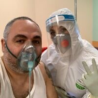 Shlomi Tova with a nurse in a coronavirus ward at Galilee Medical Center (Shlomi Tova)