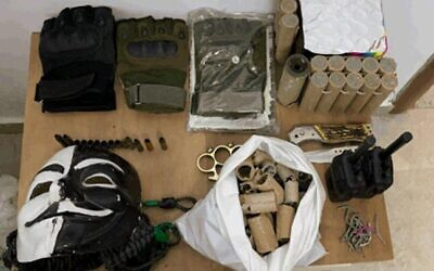 Weapons and other contraband that was found in the possession of a Palestinian teenager suspected of working on behalf of the Hamas terror group in a photograph released by the Shin Bet security service on November 9, 2020.