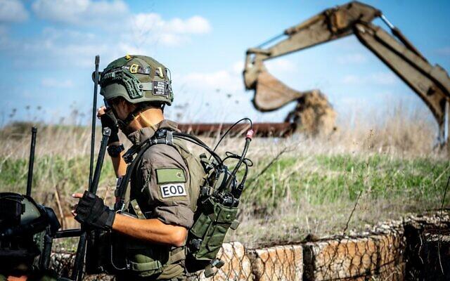 A combat engineer removes three anti-personnel mines that Israel says were planted inside Israeli-controlled territory along the border with Syria, on November 17, 2020. (Israel Defense Forces)