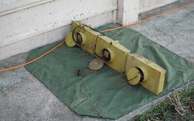 Three anti-personnel mines that Israel says were planted inside Israeli-controlled territory along the border with Syria, which were uncovered on November 17, 2020. (Israel Defense Forces)