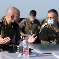 IDF Chief of Staff Aviv Kohavi, right, speaks with the head of the 210th 'Bashan' Division overlooking the Syrian border on November 29, 2020. (Israel Defense Forces)