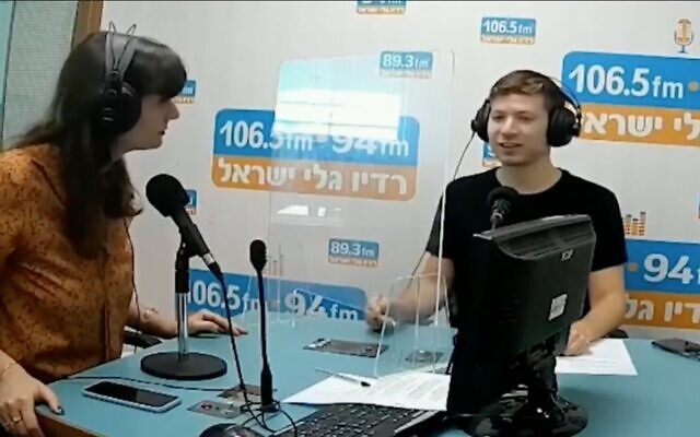 Screen capture from video of Yair Netanyahu, right, during an interview with the Galei Israel radio station. (Twitter)