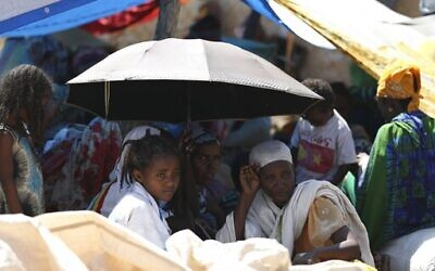 Refugees from the Tigray region of Ethiopia wait to register at the UNCHR center at Hamdayet, Sudan on November. 14, 2020.  (AP/Marwan Ali)