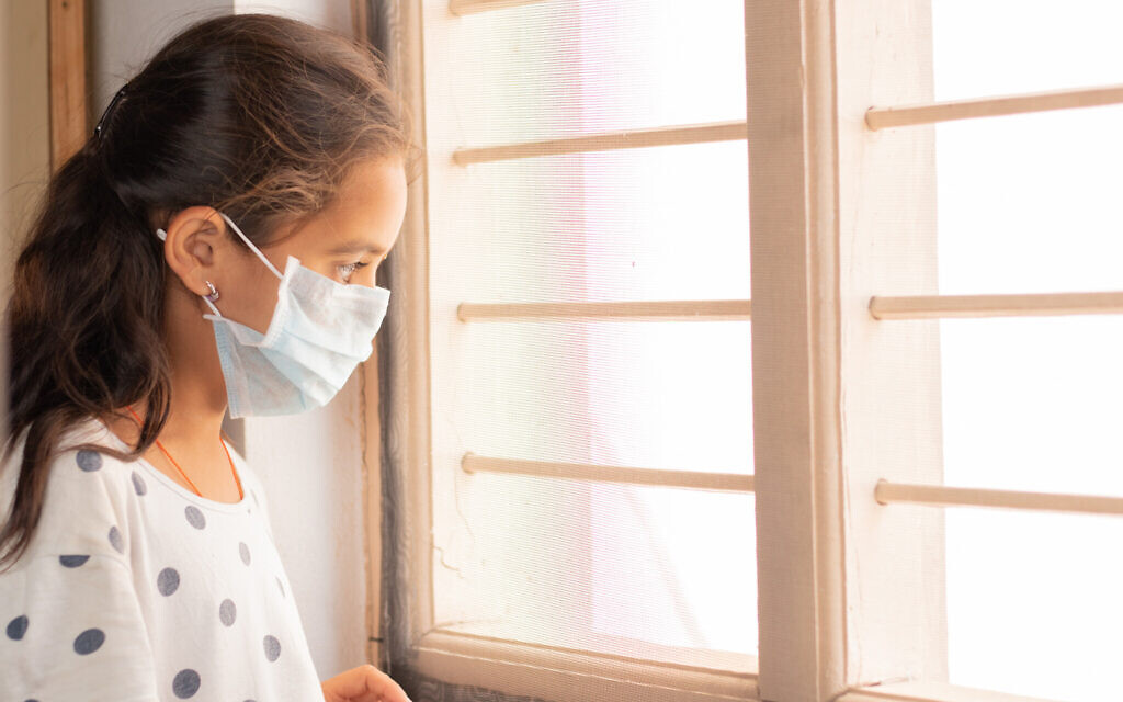 Illustrative photo of a young girl at home during coronavirus lockdown. (iStock photo/ lakshmiprasad S)