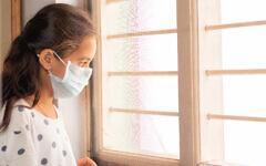 Illustrative photo of a young girl at home during coronavirus lockdown. (iStock photo/ lakshmiprasad S)