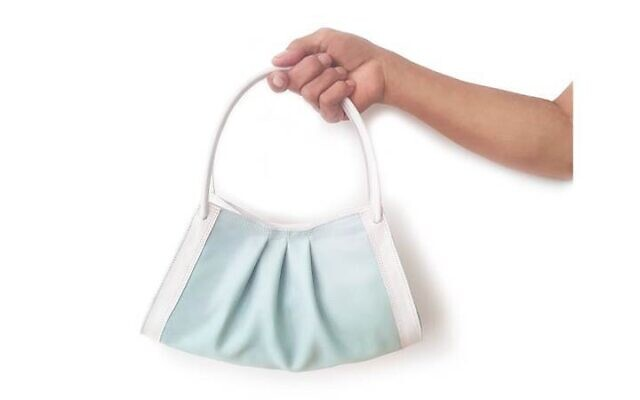Kobi Levi's Face It handbag, inspired by the blue disposable masks worn by many during COVID-19 (Courtesy Kobi Levi)