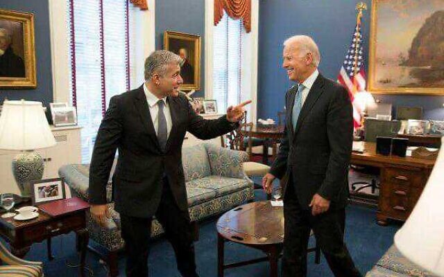 Yesh Atid lead Yair Lapid (L) and former vice president Joe Biden in an undated photo (Courtesy)