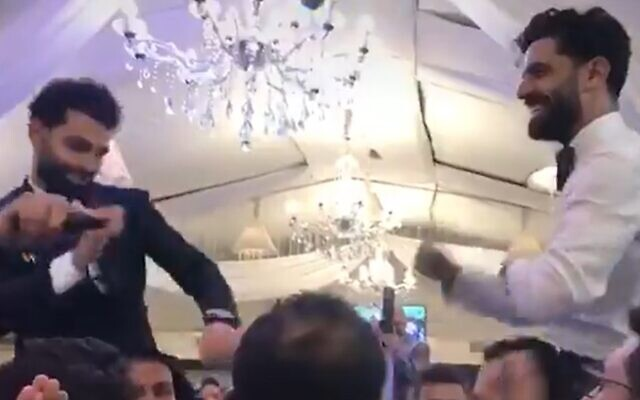 Egypt and Liverpool's Mohamed Salah dances with his brother at his Cairo wedding, days before he announced he had contracted the coronavirus (Screen grab/Tiktok user Abdallah.ali22)