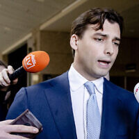 Dutch right-wing leader of the Forum for Democracy (FVD) party Thierry Baudet (C) speaks to the press in the Senate of the Netherlands, on February 5, 2020, in the Hague. (Photo by Sem VAN DER WAL / ANP / AFP)