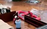 Resident is rescued after their home floods in Ness Ziona, November 21, 2020 (Screen grab/Channel 12)