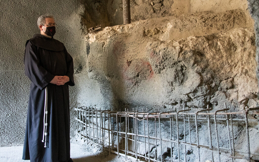 Fr. Francesco Patton, Custos of the Holy Land, next to the ancient ritual bath. (Yoli Schwartz/ Israel Antiquities Authority)