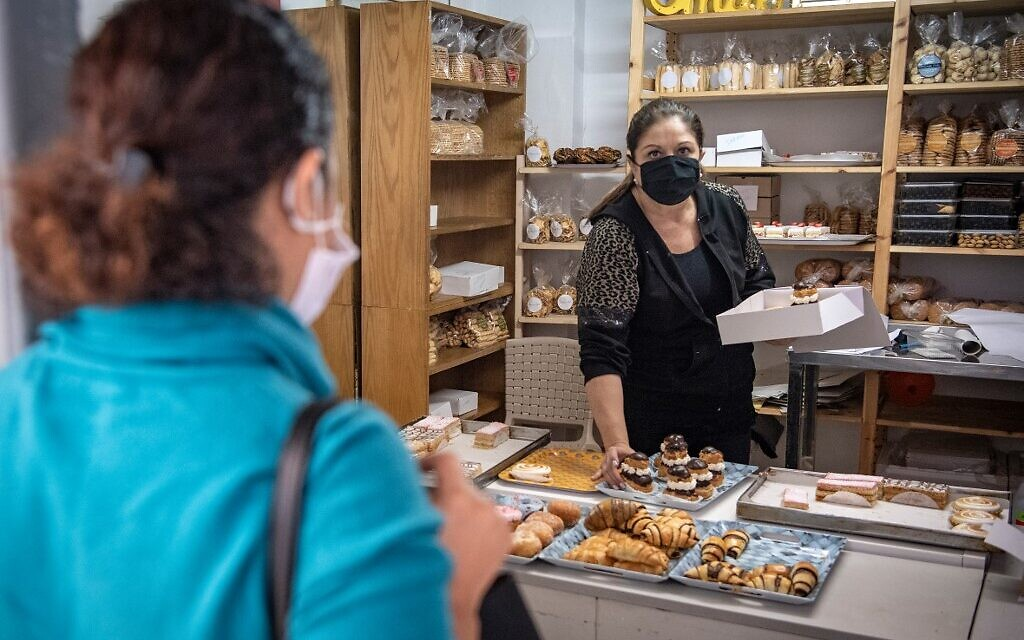 A Moroccan Jewish woman buys pastries at the kosher bakery *Madame Khal' in the western Moroccan port city of Casablanca, on December 11, 2020. (FADEL SENNA / AFP)