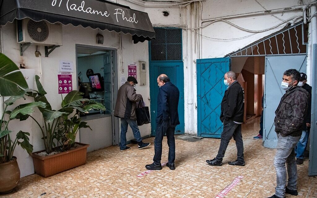 Moroccan Jewish and Muslim men queue in front of the kosher pbakery 'Madame Khal' in the western Moroccan port city of Casablanca, on December 11, 2020. (FADEL SENNA / AFP)
