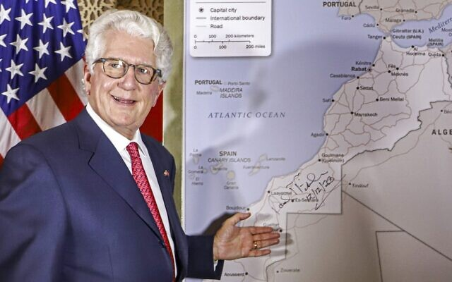 David Fischer, the US ambassador to Morocco, stands before a new US State Department map of Morocco recognizing the internationally-disputed territory of the Western Sahara (bearing a signature by Fischer) as a part of the North African kingdom, in the Moroccan capital Rabat on December 12, 2020. (AFP)