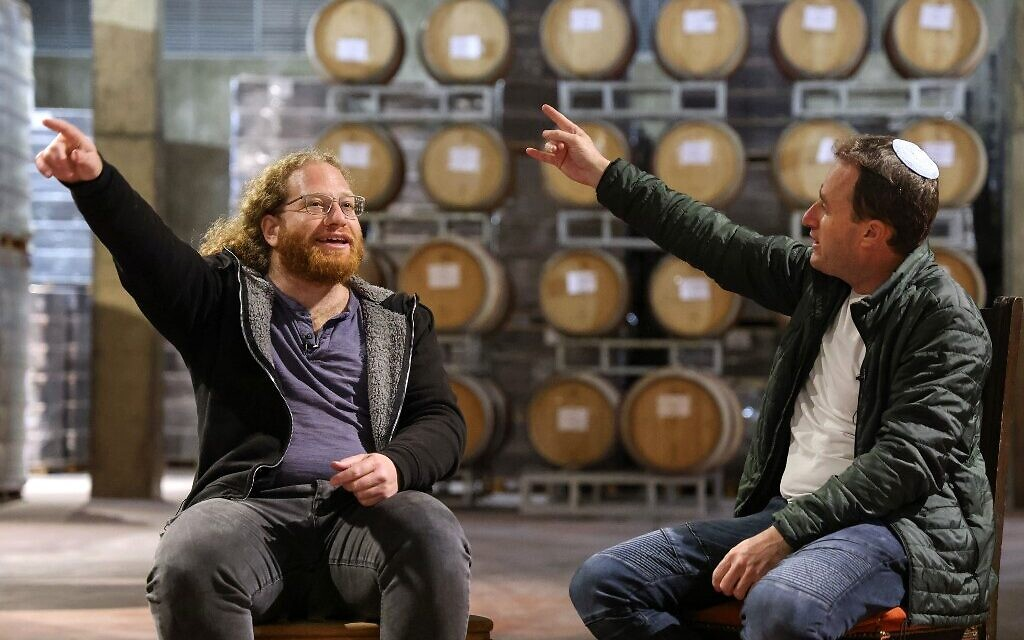 The Berg brothers, Yaakov, 44 (R) and Yonatan Berg, 39, debate at the Psagot Winery, owned by Yaakov, in the industrial park of Sha'ar Binyamin near the Psagot settlement where they grew up, in the West Bank on December 12, 2020 (Emmanuel DUNAND / AFP)