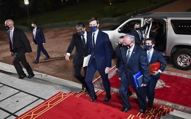 US Presidential adviser Jared Kushner, center, and National Security Adviser Meir Ben Shabbat, center-right, arrive at the Royal Palace in the Moroccan capital Rabat, December 22, 2020. (Fadel Senna/AFP)