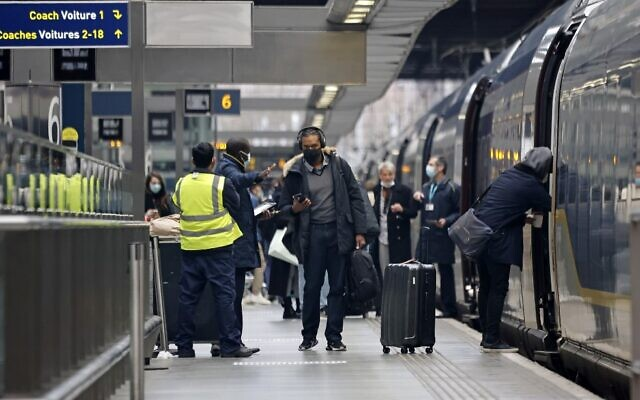 Passengers board a Eurostar train at St Pancras International station in London on December 23, 2020, as services prepare to resume following a 48 hour closure of the French border, due to a new coronavirus strain being discovered in the UK. (Tolga Akmen/AFP)