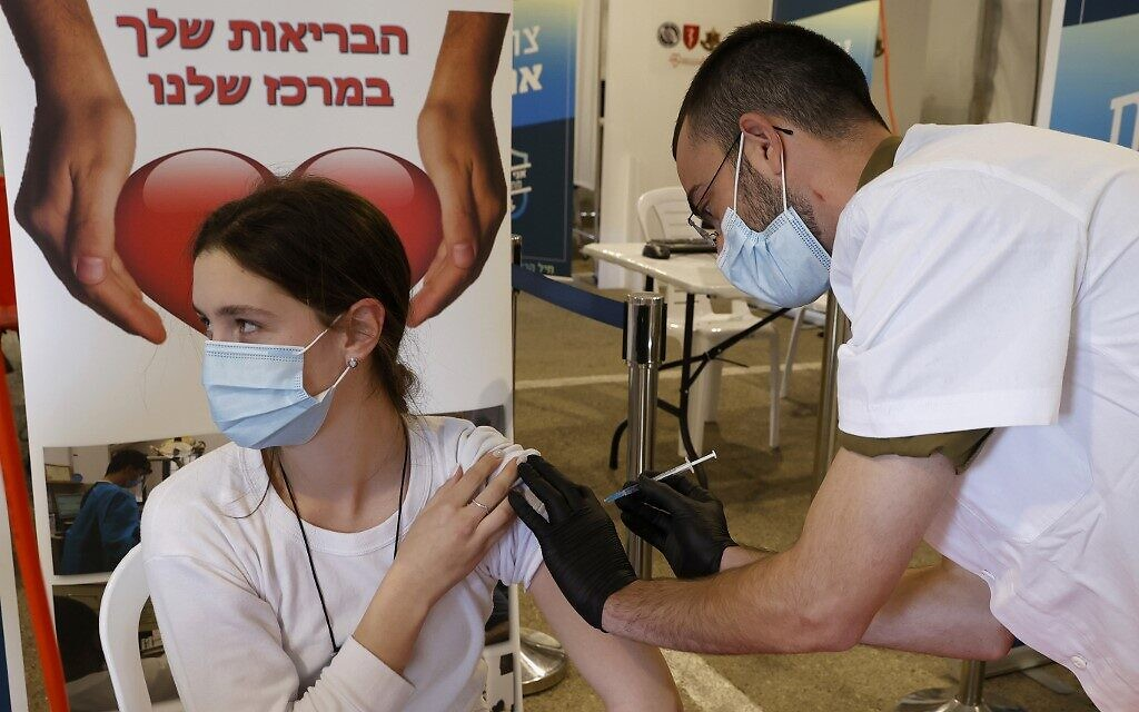 An IDF medic gets vaccinated against the COVID-19 coronavirus at the medical center of Tzrifin military base in Rishon Lezion on December 28, 2020. (JACK GUEZ / AFP)