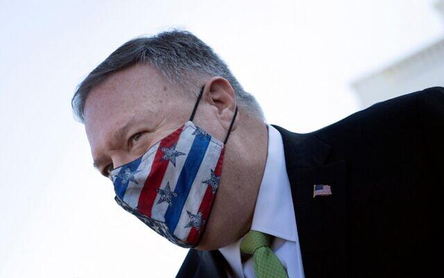 US Secretary of State Mike Pompeo leaves the White House in Washington on December 11, 2020. (Brendan Smialowski/AFP)