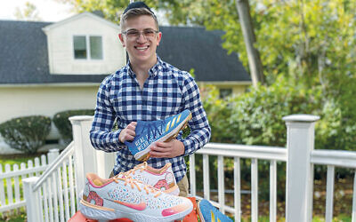 Ari Solomon displays some of the cleats he's designed. (Courtesy)