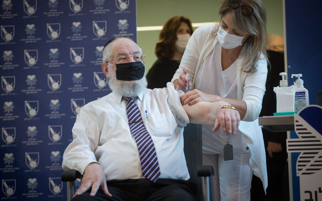 Former chief rabbi of Israel, Rabbi Yisrael Meir Lau, receives a COVID-19 vaccine at Tel Aviv Sourasky Medical Center, December 20, 2020. (Miriam Alster/Flash90/ via JTA)