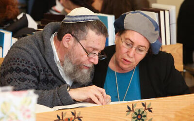 Rabbi Yehuda Herzl Henkin, left, and his wife, Chana, started a groundbreaking program for Orthodox women to answer questions of Jewish law. (Courtesy of Nishmat/ via JTA)