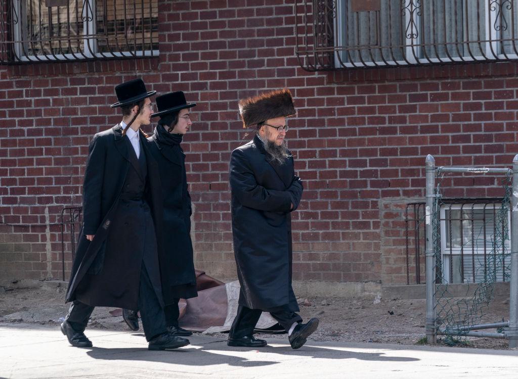 Hasidic Jewish men walking on streets during Coronavirus outbreak in Williamsburg neighborhood of Brooklyn, March 21, 2020. (Photo by Lev Radin/Pacific Press/LightRocket via Getty Images/ via JTA)