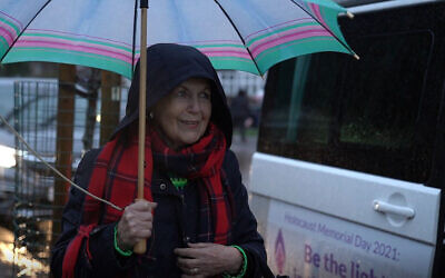 Holocaust survivor Mala Tribich stands outside the Learning from the Righteous mobile studio in London, UK in December 2020. (Learning from the Righteous/ via JTA)