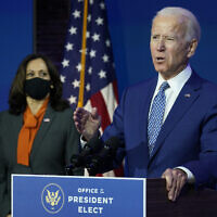 US President-elect Joe Biden, joined by Vice President-elect Kamala Harris, speaks at The Queen theater, Monday, Nov. 9, 2020, in Wilmington, Del. (AP Photo/Carolyn Kaster)